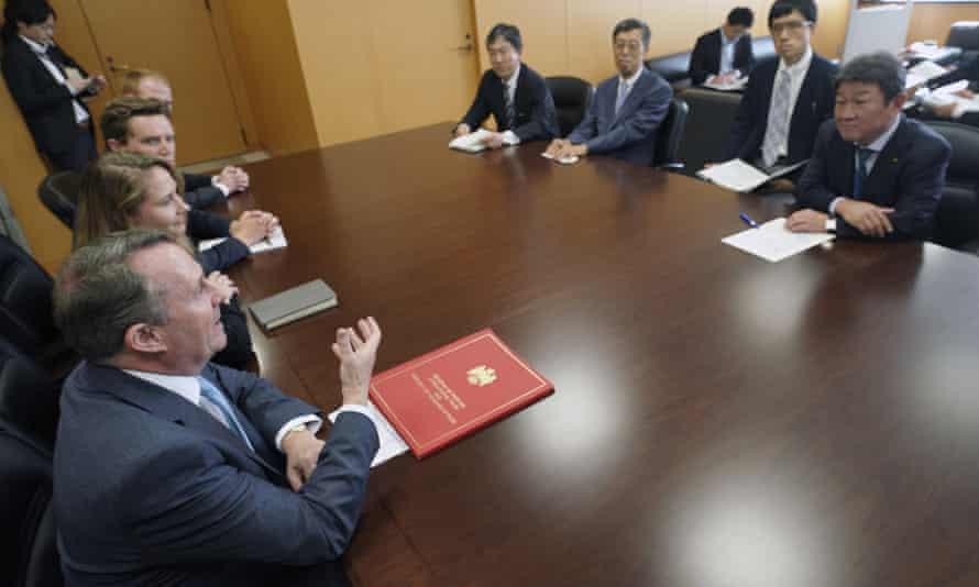 The international trade secretary, Liam Fox, bottom right, meets Japan's trade minister, Toshimitsu Motegi, far right, in Tokyo last summer