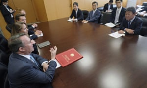 Liam Fox (left) with the Japanese minister of economic revitalization, Toshimitsu Motegi (right) at a meeting in Tokyo