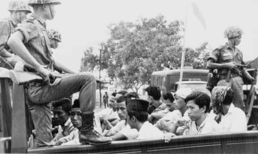Members of the Indonesian communist party's youth wing are taken to prison in Jakarta in 1965.