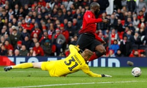 Romelu Lukaku rounds Reading's keeper Anssi Jaakkola and slots the ball home for Manchester United's second goal.