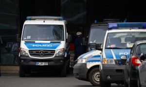 Police vehicles parked in front of Deutsche Bank headquarters today.