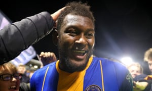 Aaron Pierre is mobbed after his winning goal against Bristol City.