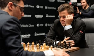 Fabiano Caruana (left) and Magnus Carlsen study the board at World Chess Championship in London