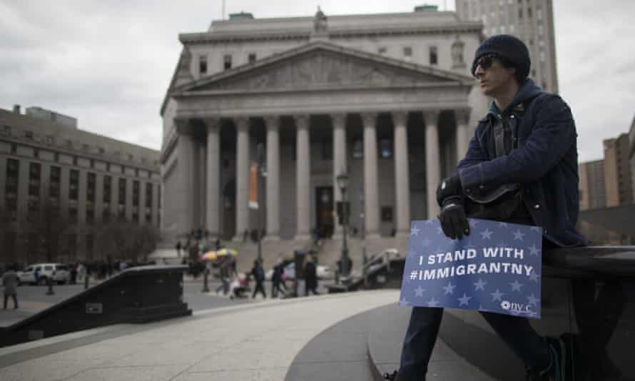 A demonstrator outside the New York Sate Supreme court before taking part in Jummah, a Muslim Friday prayer service.