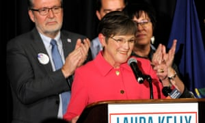 Democrat Laura Kelly celebrates her victory over Kris Kobach in the Kansas governor's race.