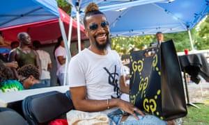 Stylist Ryan Christopher hangs out backstage at the Pure Heat Community Festival at Piedmont Park in Atlanta, Ga. on 2 Sept. 2018. The festival is the largest event of Atlanta Black Pride weekend. Photograph: Bita Honarvar © 2018 Bita Honarvar