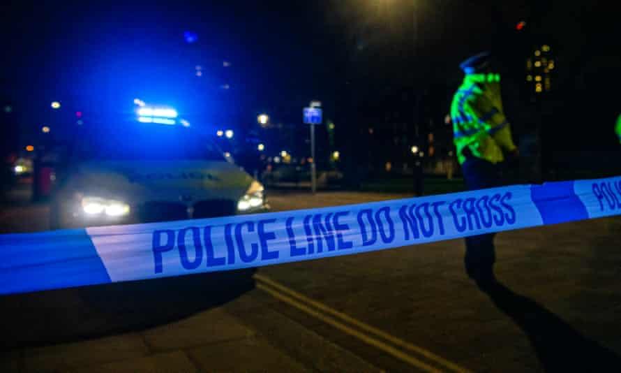 Police at night-time crime scene