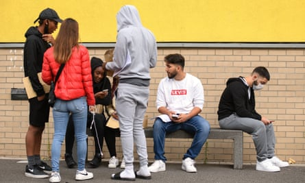 Students discuss their options after receiving their A-level results at City Academy in Hackney, east London