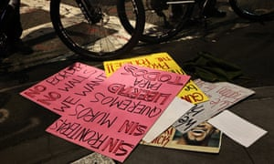 Protest signs are seen on the ground after a car struck multiple people at a protest, 11 December 2020 in New York City.