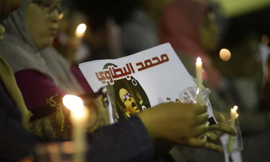 Egyptian journalists demand the release of their colleague Mohammed Al-Battawy in Cairo last week.