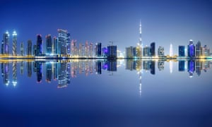 Night view of Dubai's Business Bay district, which includes the Adrian Smith-designed Burj Khalifa.