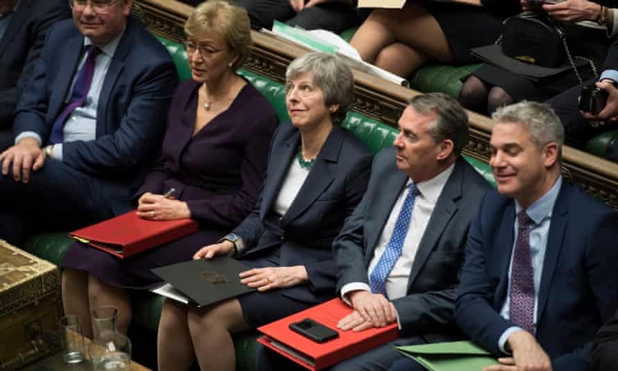 Theresa May in parliament after MPs voted to reject leaving the EU without a deal.