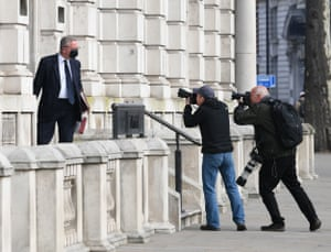 Michael Gove being photographed outside the Cabinet Office this morning.