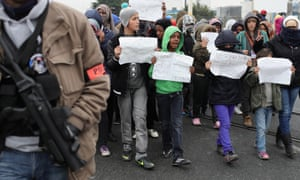 Refugee children protest to the UK authorities as French officials clear the Calais camp on 26 October.