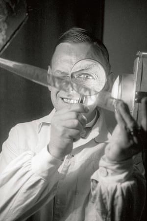 Portrait of Dr. Paul Wolff by Alfred Tritschler, with magnifying glass and 35mm negative, 1929