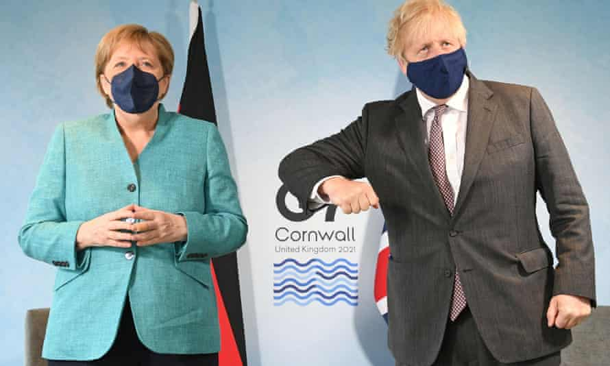 Johnson attempts to bump elbows with German chancellor Angela Merkel before their meeting on Saturday.