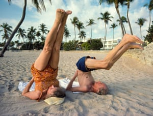 Eli and Helen Fricklas doing outdoor early morning yoga exercises on Miami Beach, Florida, 1985