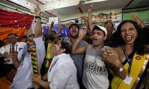 Indian activists celebrate after the hearing.