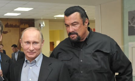 Vladimir Putin and Steven Seagal visit a new sports arena in Moscow in 2013.