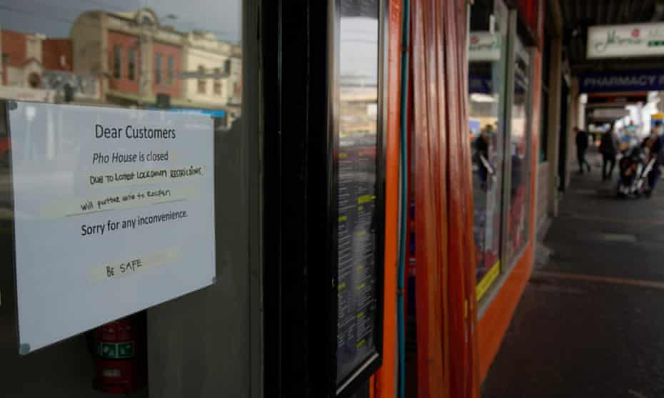 A sign hangs on the door of a closed restaurant after lockdown restrictions were implemented in response to an outbreak of the coronavirus disease in Melbourne.