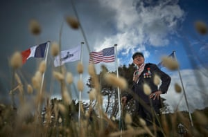 American veteran of the D-Day landings and now a local, Charles Norman Shay, stands looking over Omaha Beach in Normandy.