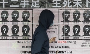 A student puts up a banner at the University of Hong Kong demanding the release of activists