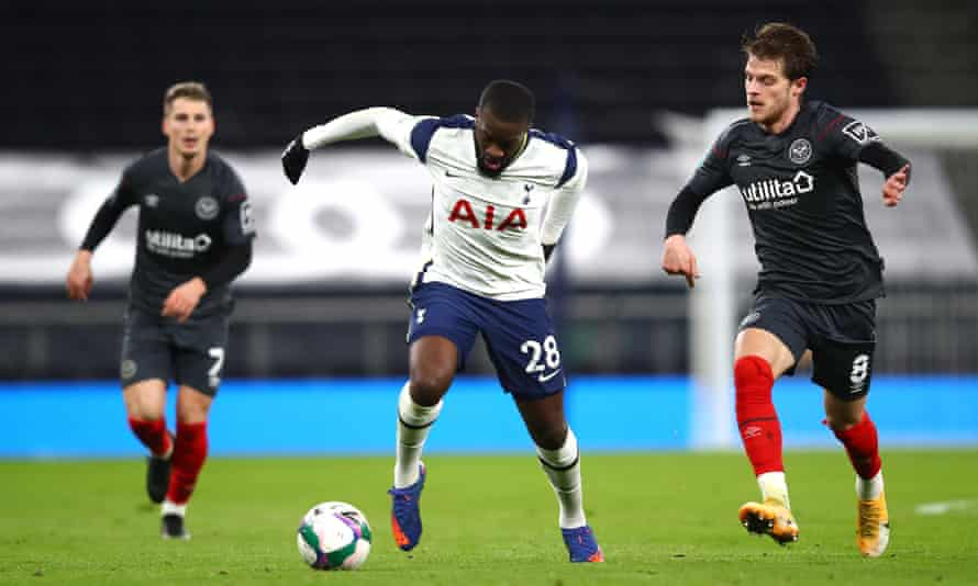Tanguy Ndombele carried the ball away from Brentford's Mathias Jensen during Tottenhaam's Carabao Cup semi-final victory.