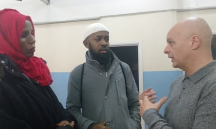 Nigel Bromage (right) talks with members of the Muslim Welfare House congregation.