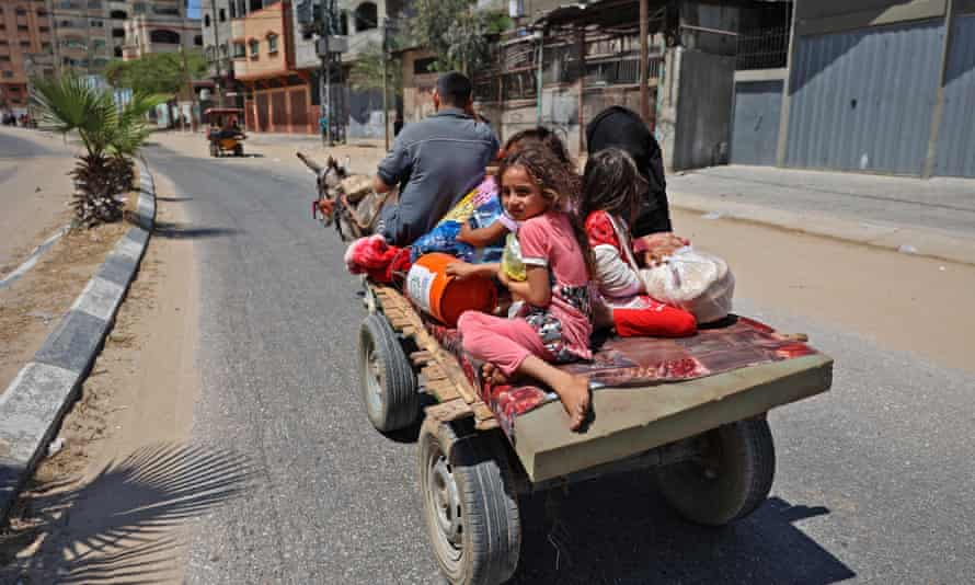 A Palestinian family flees their home in Beit Lahya in the northern Gaza Strip