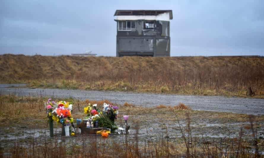 Flowers for earthquake victims have been placed near the tsunami-stricken town of Namie in Fukushima prefecture.