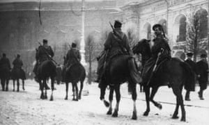 Cossack troops on patrol in St Petersburg during the Russian Revolution.