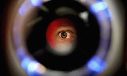 A man uses an iris recognition scanner during the Biometrics 2004 exhibition and conference