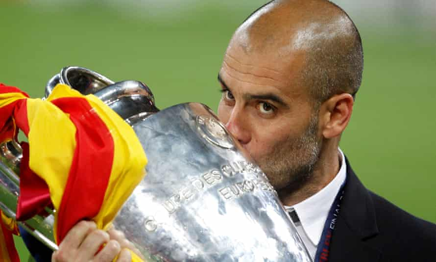 Pep Guardiola with the Champions League trophy after Barcelona beat Manchester United in the final at Wembley in 2011