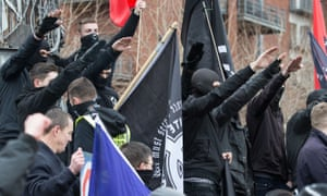 People perform Nazi salutes in a 'White Man March' under the banner of 'National Action'
