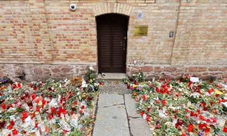 A makeshift memorial of candles and flowers outside of the synagogue in Halle an der Saale, eastern Germany.