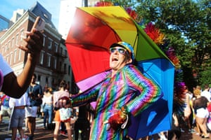 New York, US. A reveller poses for photo during the Pride march. A smaller rally through West Village took place on the sidelines of Pride-themed parties all over Greenwich Village