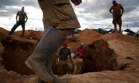 Workers dig in search of gold at an illegal mining camp near Tumeremo in Venezuela's southern Bolívar state.