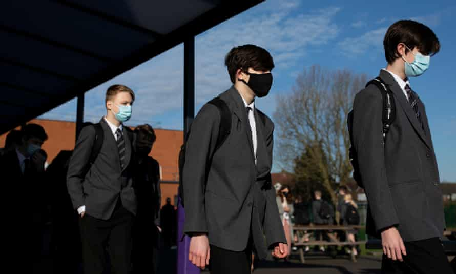 Pupils file into class on their first day back from lockdown at a secondary school in England.