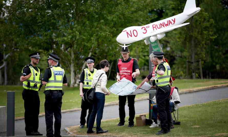 Protestors demonstrating against plans for a third Heathrow runway outside the Scottish National Party conference in Aberdeen