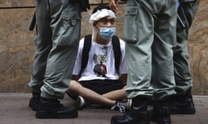Hong Kong riot police surround a protester during a debate on a controversial bill that would outlaw ridicule of the Chinese national anthem.