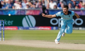 England's Mark Wood deflects a shot by New Zealand's Kane Williamson onto the wickte to run him out.