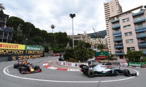 Lewis Hamilton leads Max Verstappen around a hairpin turn.