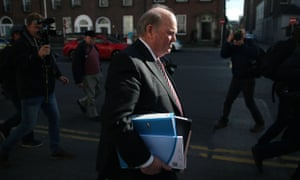Finance Minister Michael Noonan makes his way into Government buildings in Dublin to deliver the Irish Budget.