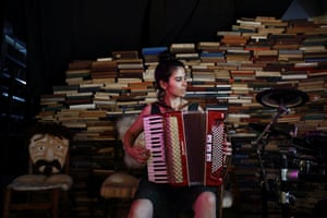 Tamar Lehman, a social counsellor for young adults with mental health issues, plays an accordion. Lehman comes to the station often to practise dancing and play music