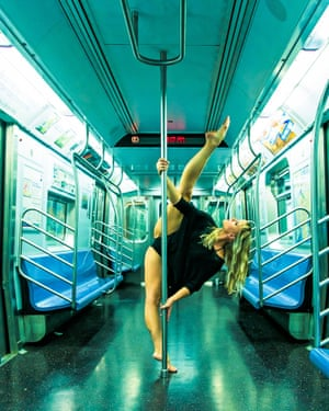 Michelle Stanek, 2012 US pole dance champion, shows off her moves on the New York subway