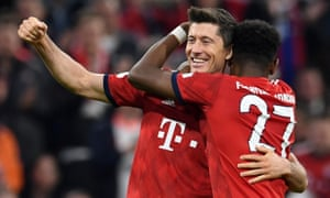 Robert Lewandowski (right) is congratulated by David Alaba after scoring Bayern Munich's fifth goal in their hammering of Borussia Dortmund.