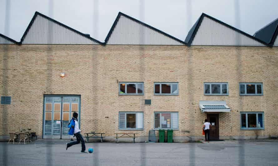 Refugees play football outside a shelter in Sundbyberg, north-west of Stockholm.