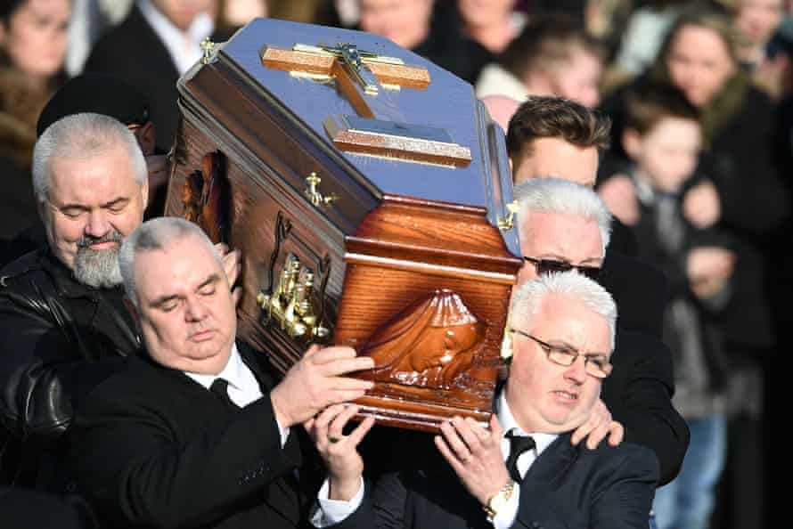 The coffin of Dolores O'Riordan is carried out of St Ailbe's church