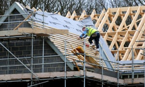 A roofer works on a new house in Derbyshire.