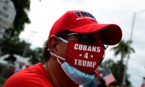 A Trump supporter attends a rally outside the 'Latinos for Trump Roundtable' event in Doral last month.